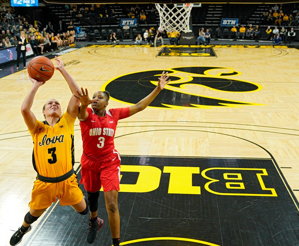 Iowa Hawkeyes guard Makenzie Meyer (3) scores a basket while being fouled by Ohio State Buckeyes guard Janai Crooms (3) during the first quarter of their game at Carver-Hawkeye Arena in Iowa City on Thursday, January 23, 2020. (Stephen Mally/hawkeyesports.com)