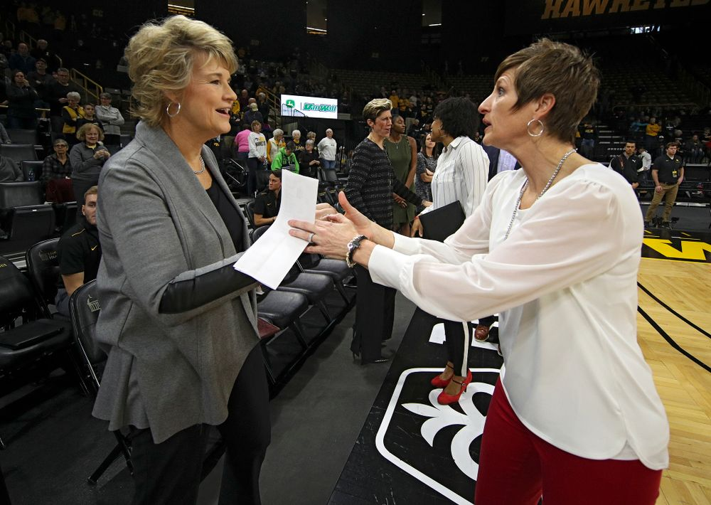Iowa Hawkeyes head coach Lisa Bluder (from left) shakes hands with Indiana Hoosiers head coach Teri Moren before the start of their game at Carver-Hawkeye Arena in Iowa City on Sunday, January 12, 2020. (Stephen Mally/hawkeyesports.com)