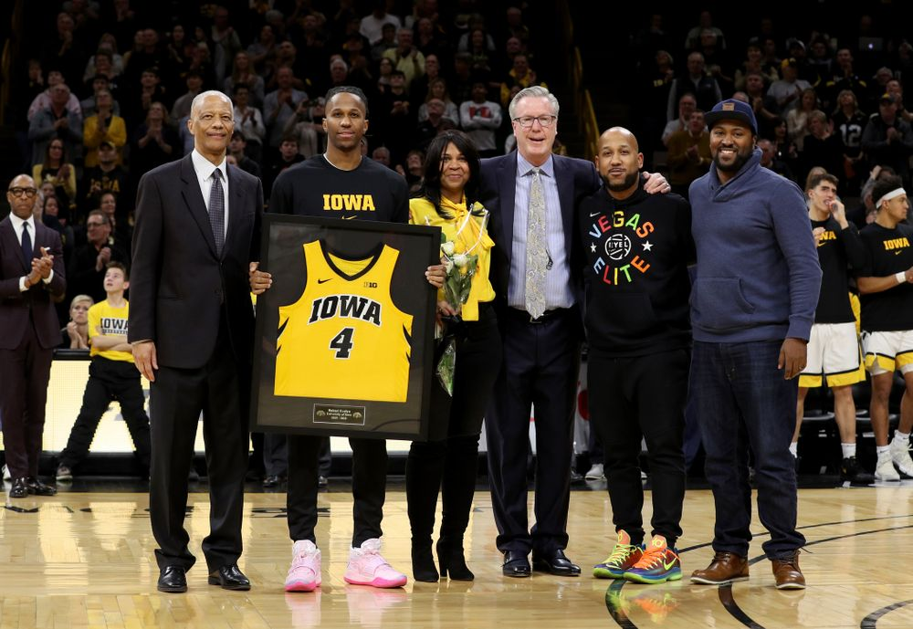 Iowa Hawkeyes guard Bakari Evelyn (4) and his family during senior night festivities before their game against the Purdue Boilermakers Tuesday, March 3, 2020 at Carver-Hawkeye Arena. (Brian Ray/hawkeyesports.com)