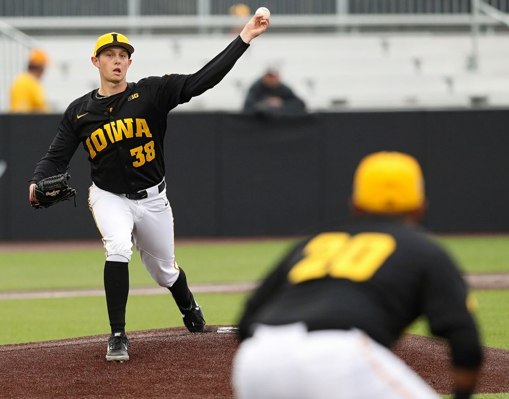 Iowa Hawkeyes pitcher Trenton Wallace (38) throws over to first baseman Izaya Fullard (20) during the third inning of their game against Western Illinois at Duane Banks Field in Iowa City on Wednesday, May. 1, 2019. (Stephen Mally/hawkeyesports.com)