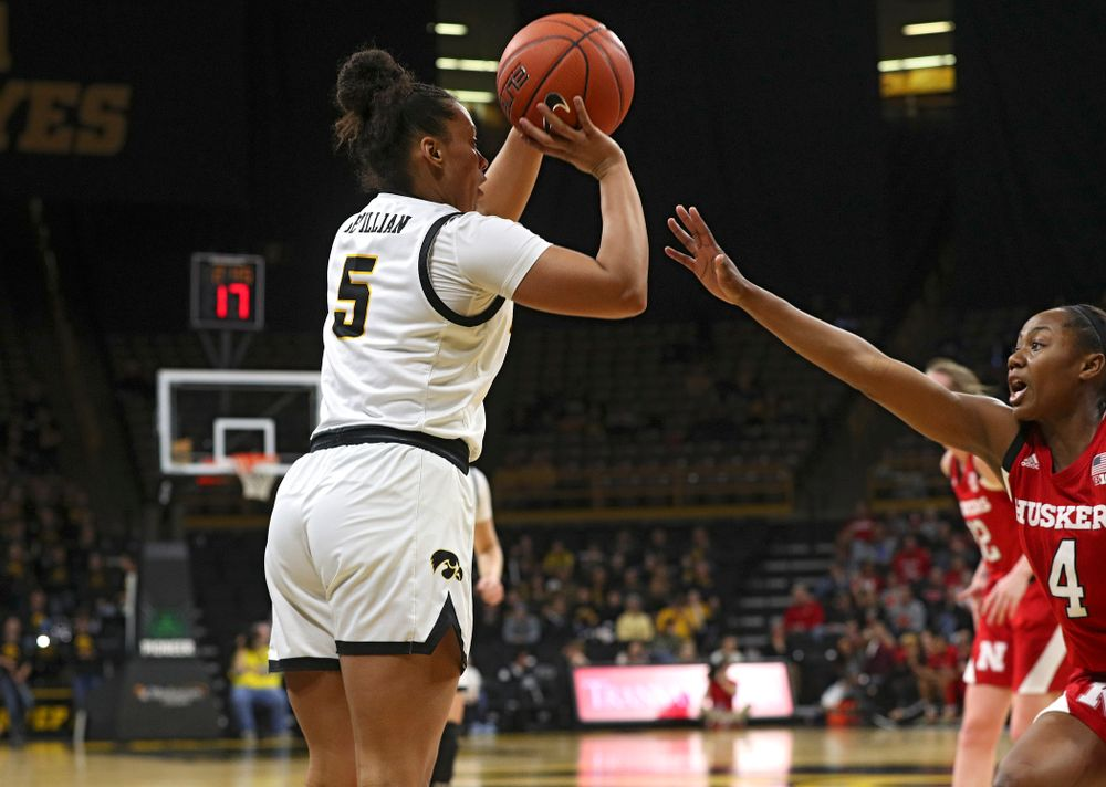 Iowa Hawkeyes guard Alexis Sevillian (5) makes a 3-pointer during the fourth quarter of the game at Carver-Hawkeye Arena in Iowa City on Thursday, February 6, 2020. (Stephen Mally/hawkeyesports.com)