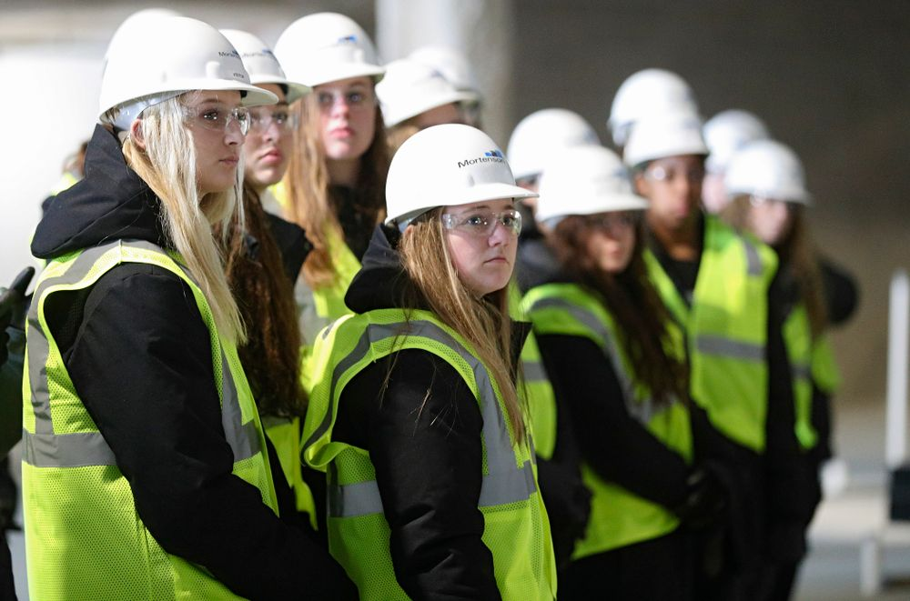 Iowa's Kyndra Hansen (from left) and Joslyn Boyer look on as the Iowa Volleyball team and staff take a construction tour of Xtream Arena in Coralville on Thursday, January 30, 2020. (Stephen Mally/hawkeyesports.com)