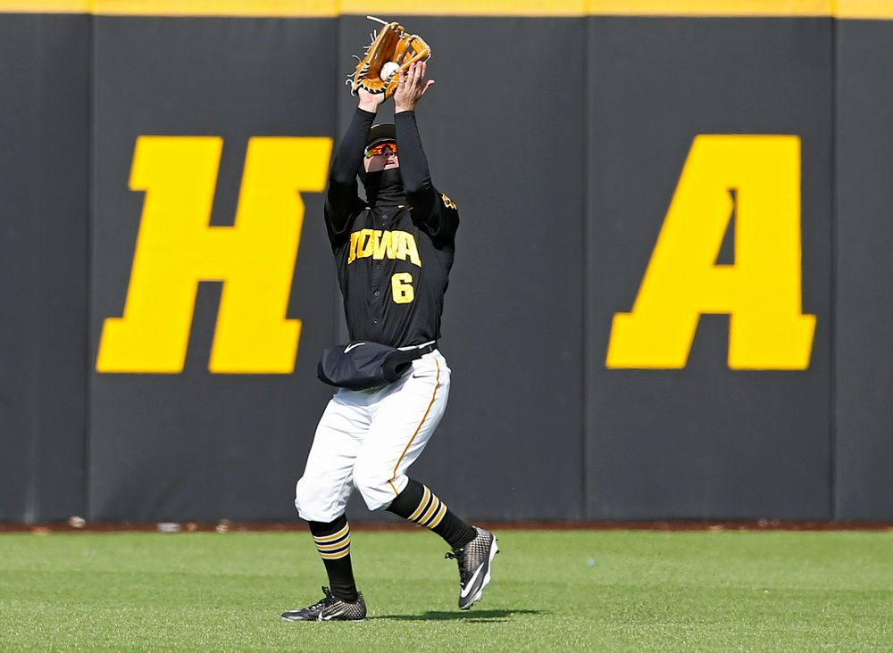 Iowa Hawkeyes center fielder Justin Jenkins (6) pulls in a fly ball for an out during the eighth inning of their game against Illinois at Duane Banks Field in Iowa City on Saturday, Mar. 30, 2019. (Stephen Mally/hawkeyesports.com)