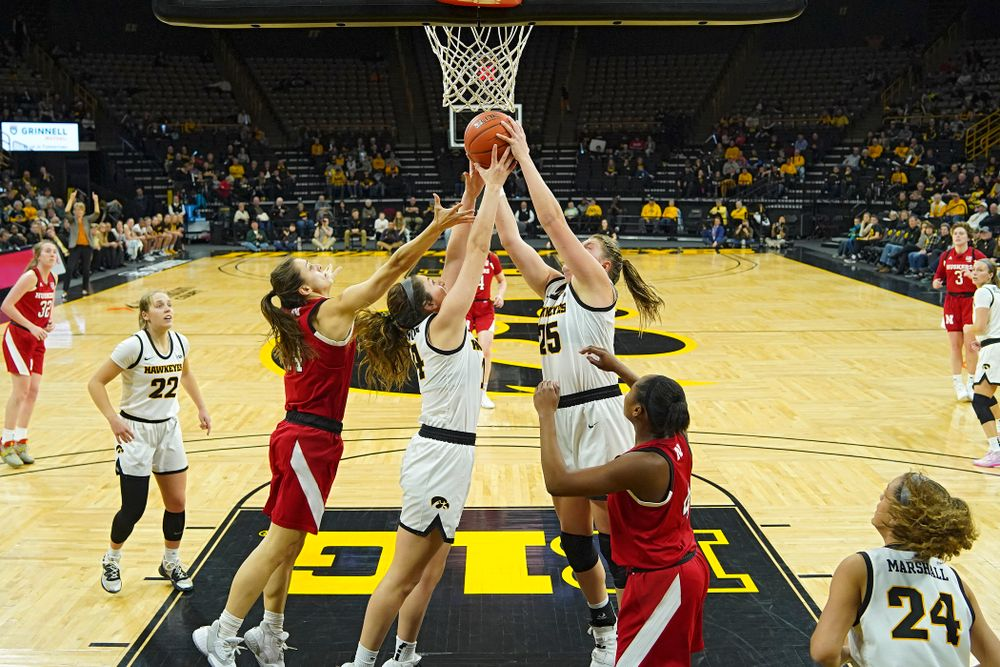 Iowa Hawkeyes guard McKenna Warnock (14) battles for a rebound with forward Monika Czinano (25) during the fourth quarter of the game at Carver-Hawkeye Arena in Iowa City on Thursday, February 6, 2020. (Stephen Mally/hawkeyesports.com)