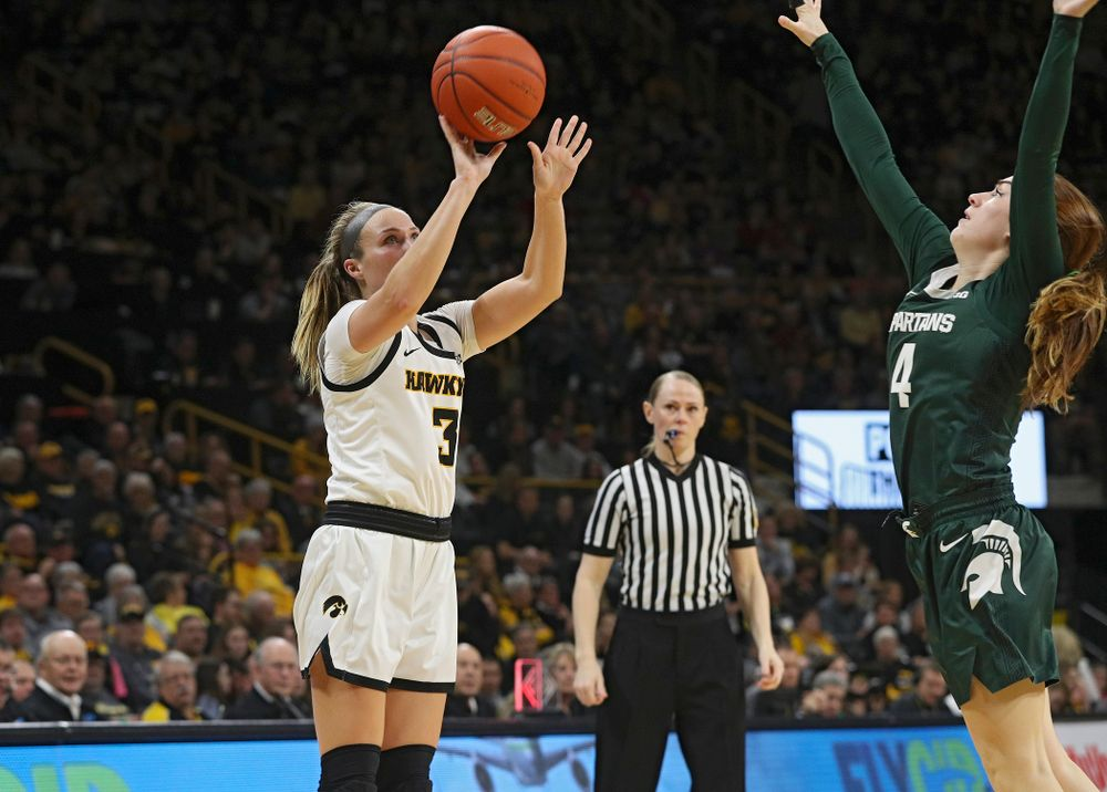 Iowa Hawkeyes guard Makenzie Meyer (3) makes a 3-pointer during the second quarter of their game at Carver-Hawkeye Arena in Iowa City on Sunday, January 26, 2020. (Stephen Mally/hawkeyesports.com)