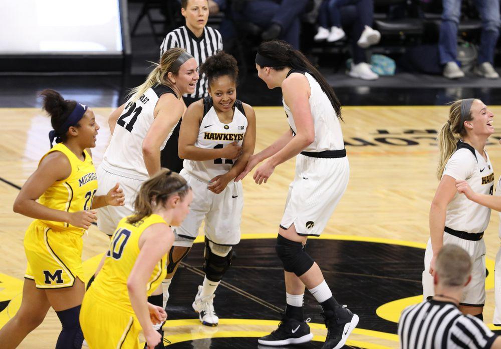 Iowa Hawkeyes forward Hannah Stewart (21), guard Tania Davis (11), and forward Megan Gustafson (10) against the Michigan Wolverines Thursday, January 17, 2019 at Carver-Hawkeye Arena. (Brian Ray/hawkeyesports.com)