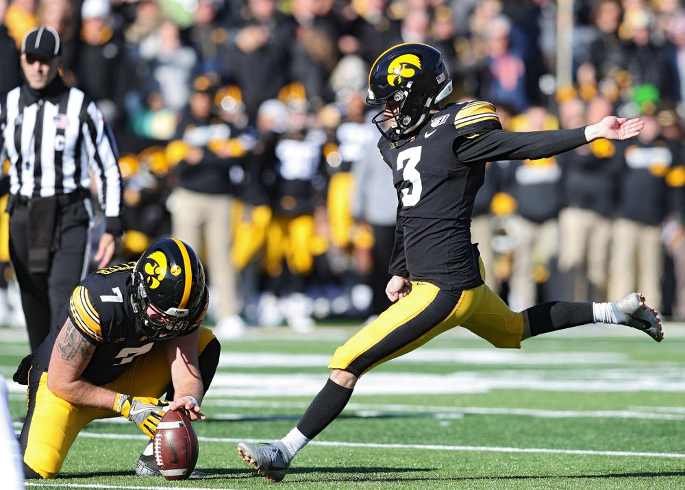 Iowa Hawkeyes place kicker Keith Duncan (3) kicks from the hold of punter Colten Rastetter (7) during the first quarter of their game at Kinnick Stadium in Iowa City on Saturday, Nov 23, 2019. (Stephen Mally/hawkeyesports.com)