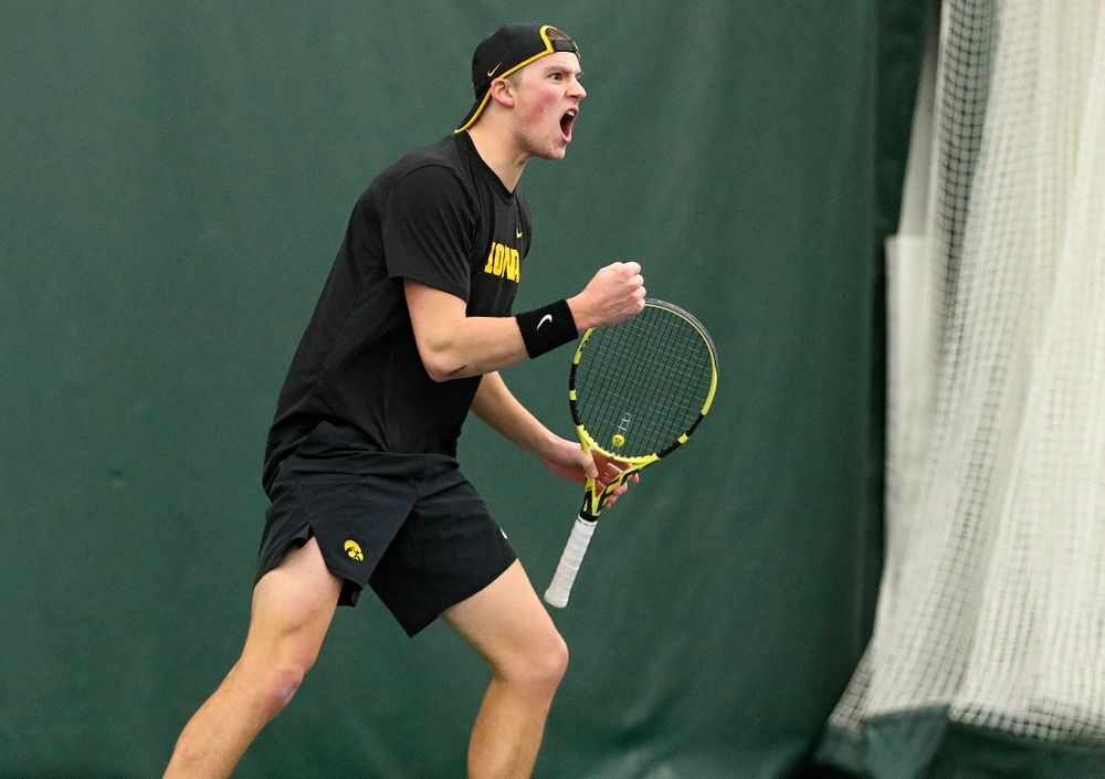 Iowa's Joe Tyler celebrates a point during his singles match at the Hawkeye Tennis and Recreation Complex in Iowa City on Friday, February 14, 2020. (Stephen Mally/hawkeyesports.com)