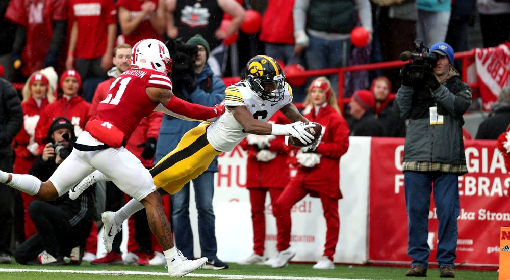 Iowa Hawkeyes wide receiver Ihmir Smith-Marsette (6) scores a touchdown against the Nebraska Cornhuskers Friday, November 29, 2019 at Memorial Stadium in Lincoln, Neb. (Brian Ray/hawkeyesports.com)