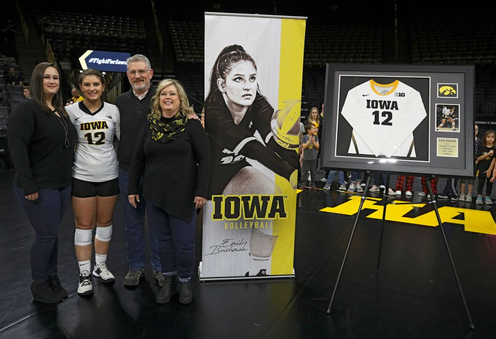 Iowa's Emily Bushman (12) is honored with her family on Senior Day before their match at Carver-Hawkeye Arena in Iowa City on Saturday, Nov 30, 2019. (Stephen Mally/hawkeyesports.com)