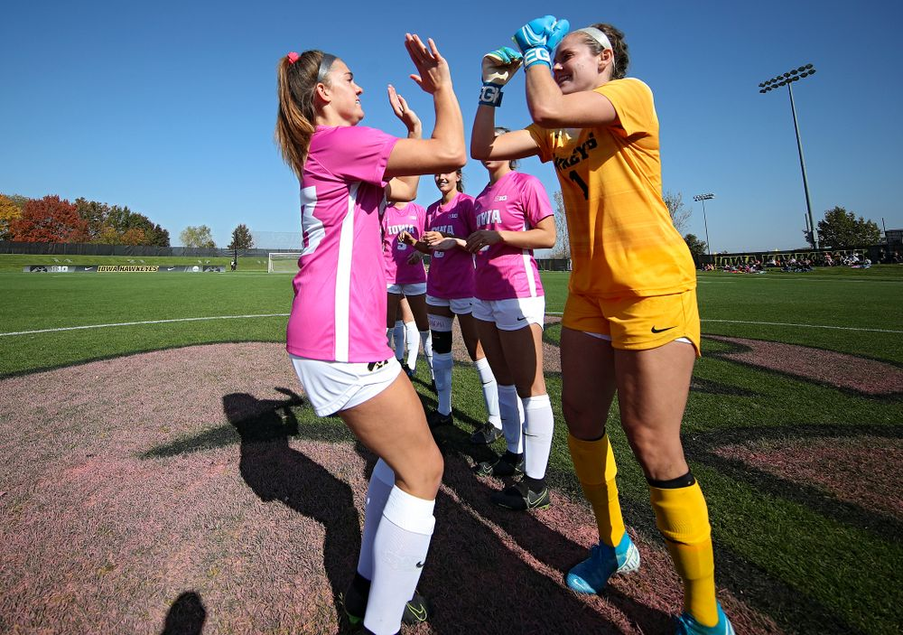 Iowa defender Riley Burns (33) high-fives goalkeeper Claire Graves (1) on the field before their match at the Iowa Soccer Complex in Iowa City on Sunday, Oct 27, 2019. (Stephen Mally/hawkeyesports.com)