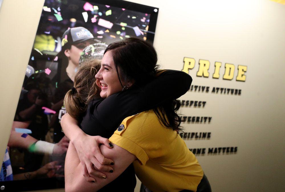 Megan Gustafson hugs Iowa Hawkeyes guard Kathleen Doyle (22) following a jersey retirement ceremony Sunday, January 26, 2020 at Carver-Hawkeye Arena. (Brian Ray/hawkeyesports.com)