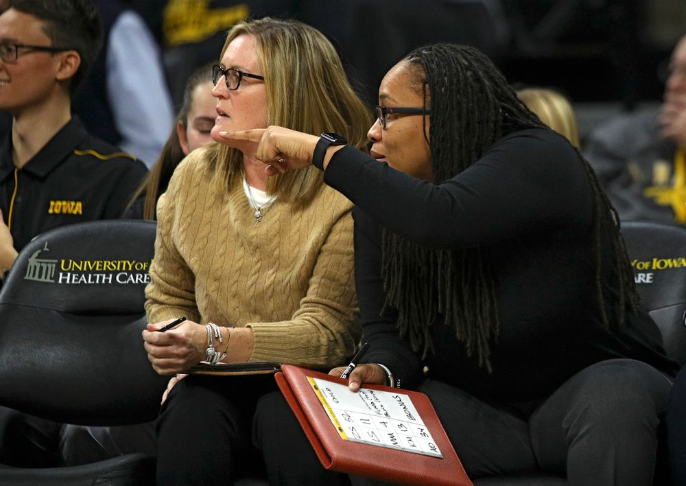 Iowa Special Assistant to the Head Coach Jenni Fitzgerald (from left) talks with assistant coach Raina Harmon during the third quarter of the game at Carver-Hawkeye Arena in Iowa City on Thursday, February 6, 2020. (Stephen Mally/hawkeyesports.com)