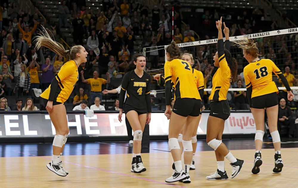 Iowa's Maddie Slagle (15), Halle Johnston (4), Courtney Buzzerio (2), Kyndra Hansen (8), Brie Orr (7), and Hannah Clayton (18) celebrate a score during their match at Carver-Hawkeye Arena in Iowa City on Sunday, Oct 20, 2019. (Stephen Mally/hawkeyesports.com)