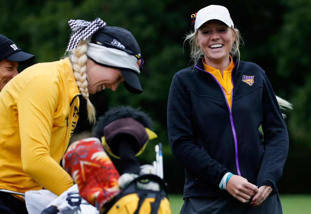 Northern Iowa assistant coach Jessie Sindlinger laughs with former teammate Shawn Rennegarbe at the eighth tee during the Diane Thomason Invitational at Finkbine Golf Course on September 29, 2018. (Tork Mason/hawkeyesports.com)