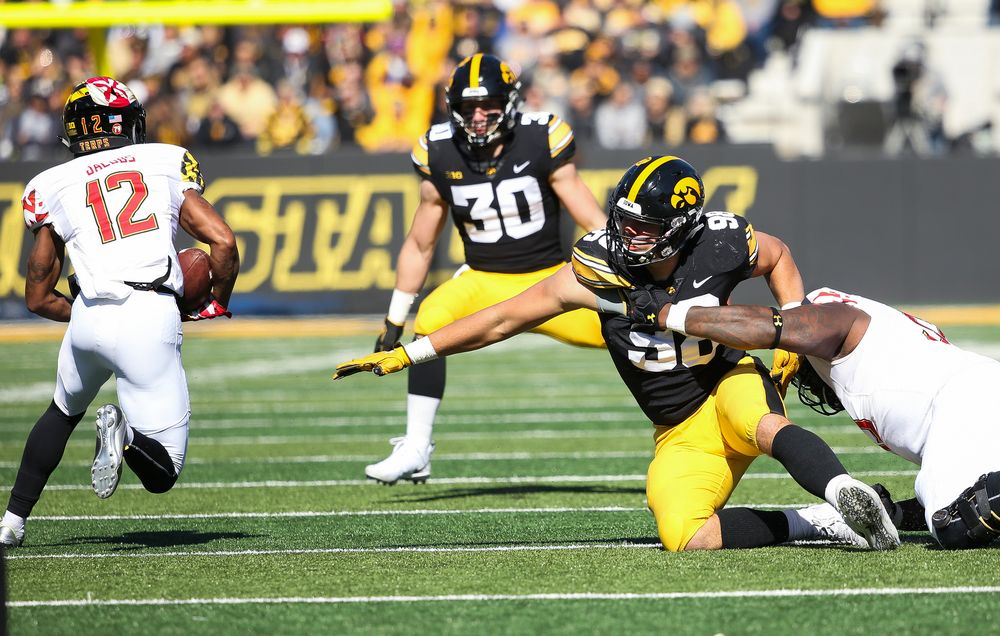 Iowa Hawkeyes defensive end Anthony Nelson (98) is held while trying to make a tackle during a game against Maryland at Kinnick Stadium on October 20, 2018. (Tork Mason/hawkeyesports.com)