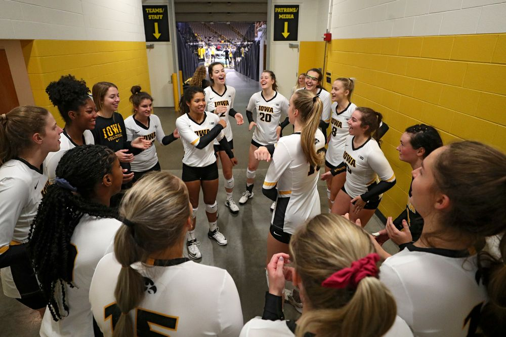 Iowa's Brie Orr (7) and Hannah Clayton (18) dance as their team huddles before the start of their volleyball match at Carver-Hawkeye Arena in Iowa City on Sunday, Oct 13, 2019. (Stephen Mally/hawkeyesports.com)